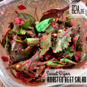 The beets and Dijon mustard blend together to coat the greens in a delicious pink dressing.
